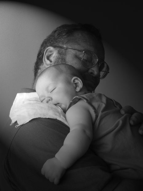 dad and baby having a cuddle